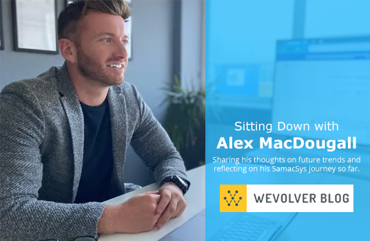 Alex MacDougall sitting at a desk